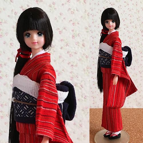 こぎん刺しの帯と紬の着物を着る黒髪のジェニー